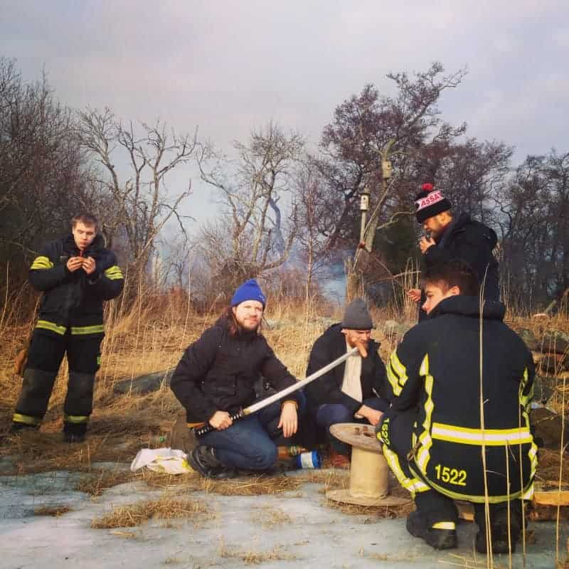 Sami Sänpäkkilä, Mika Rättö and Harri Sippola grilling sausages with the Reposaari fire brigade.