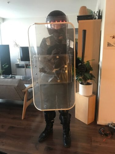 Testing the riot gear costume with Elissa