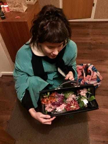 Heta and her bag of flowers